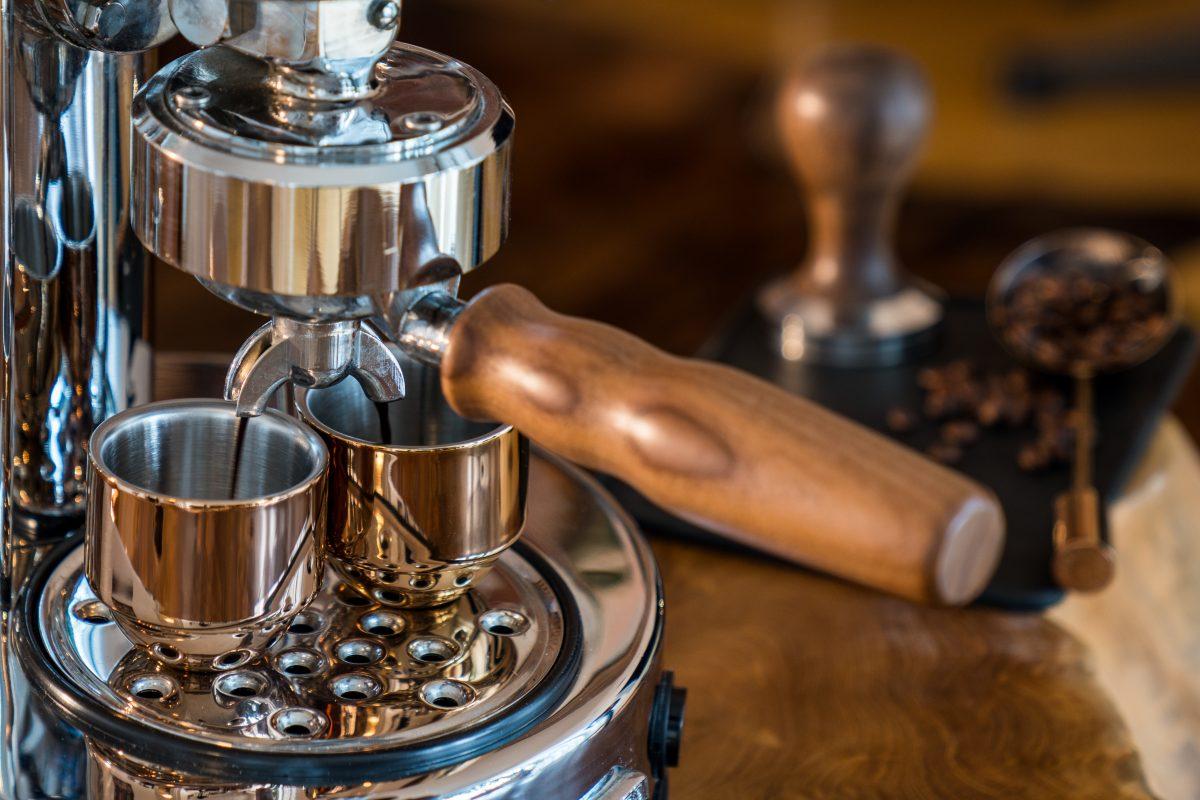 Pouring fresh espresso with high end Barista Espresso Machine at home